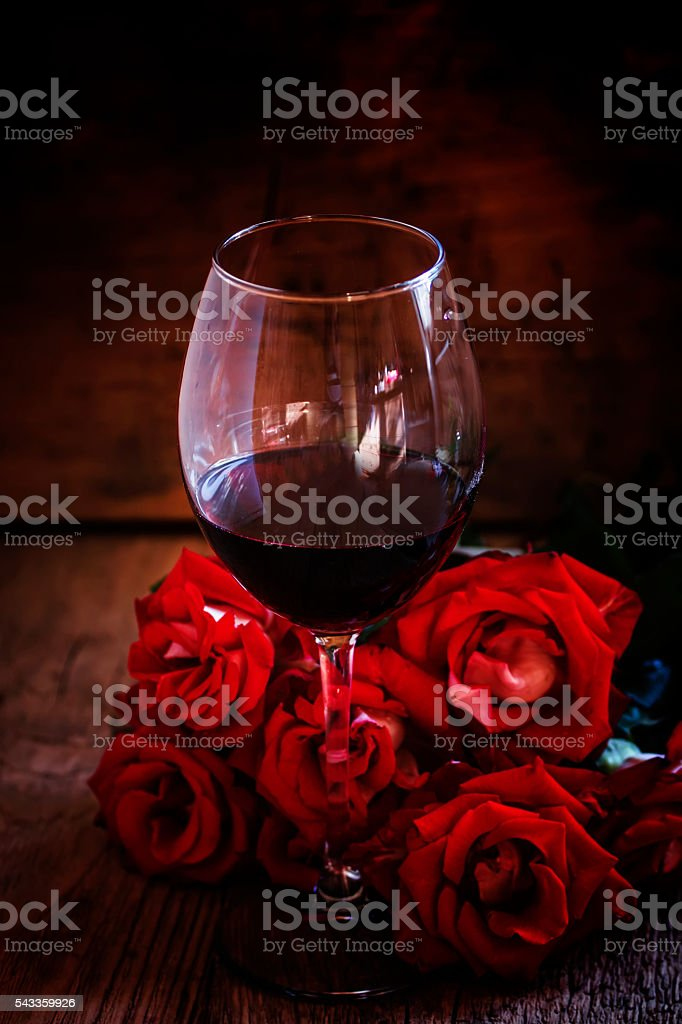 Red wine and red roses stock photo