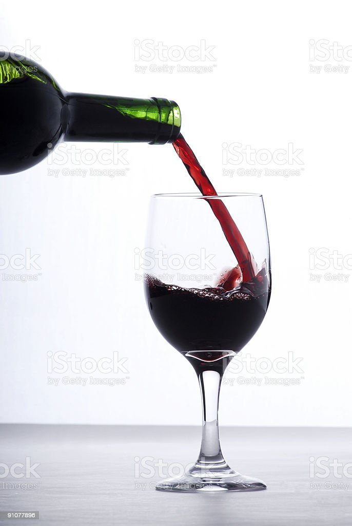 Red wine being poured into a glass royalty-free stock photo