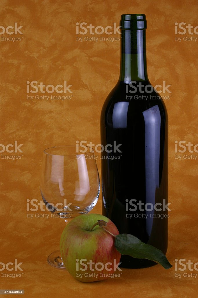 Red Wine Bottle and Apple royalty-free stock photo