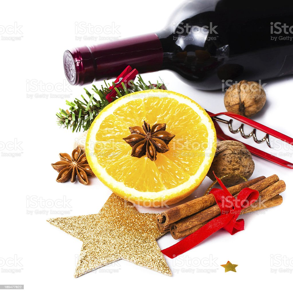Red wine bottle and spices for Christmas Hot Mulled royalty-free stock photo