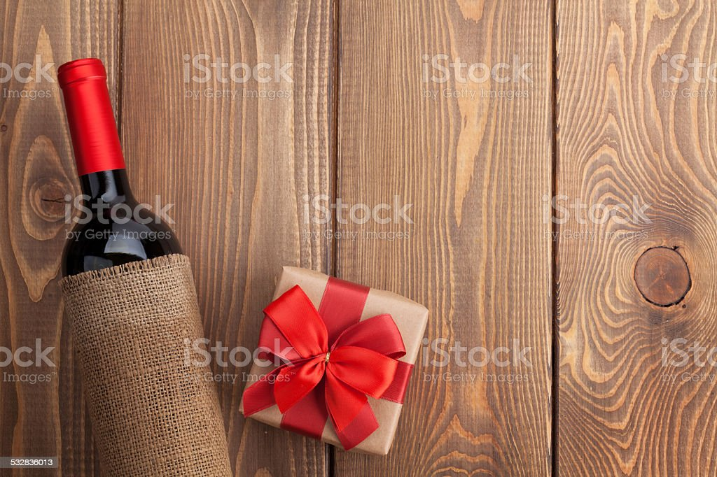 Red wine bottle and valentines day gift box stock photo