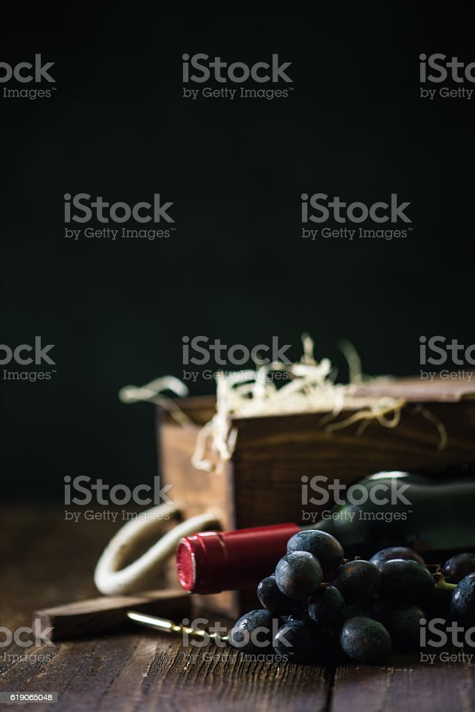Red wine bottle and wooden crate stock photo