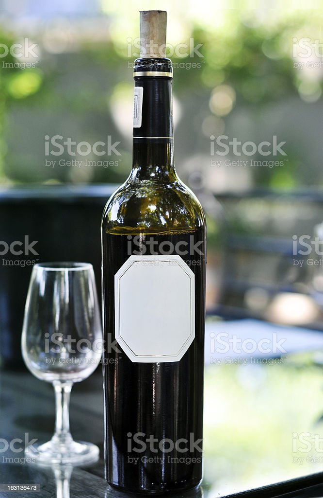 Red wine bottle on table stock photo