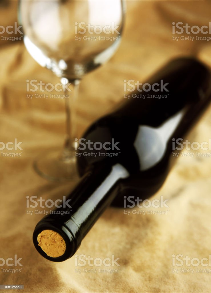 Red Wine Bottle with Glass on Table royalty-free stock photo