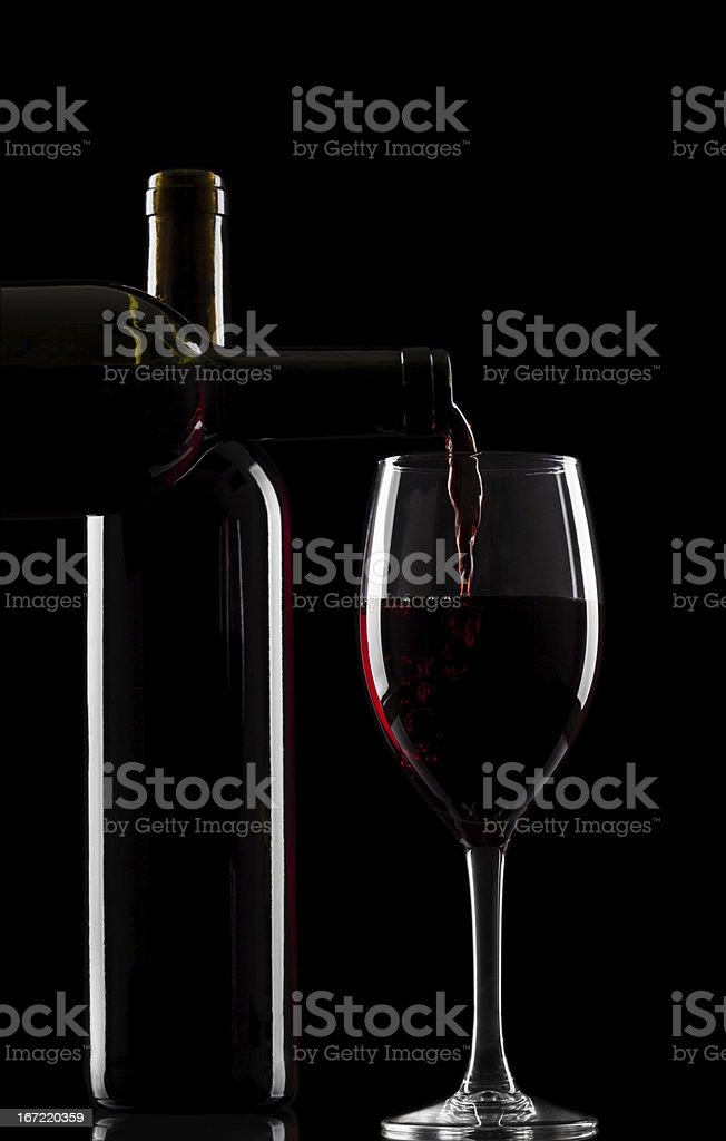 Red wine bottles and glass royalty-free stock photo