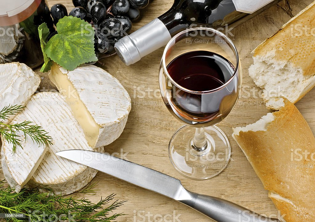 Red wine, Brie and Camembert cheeses with bread stock photo