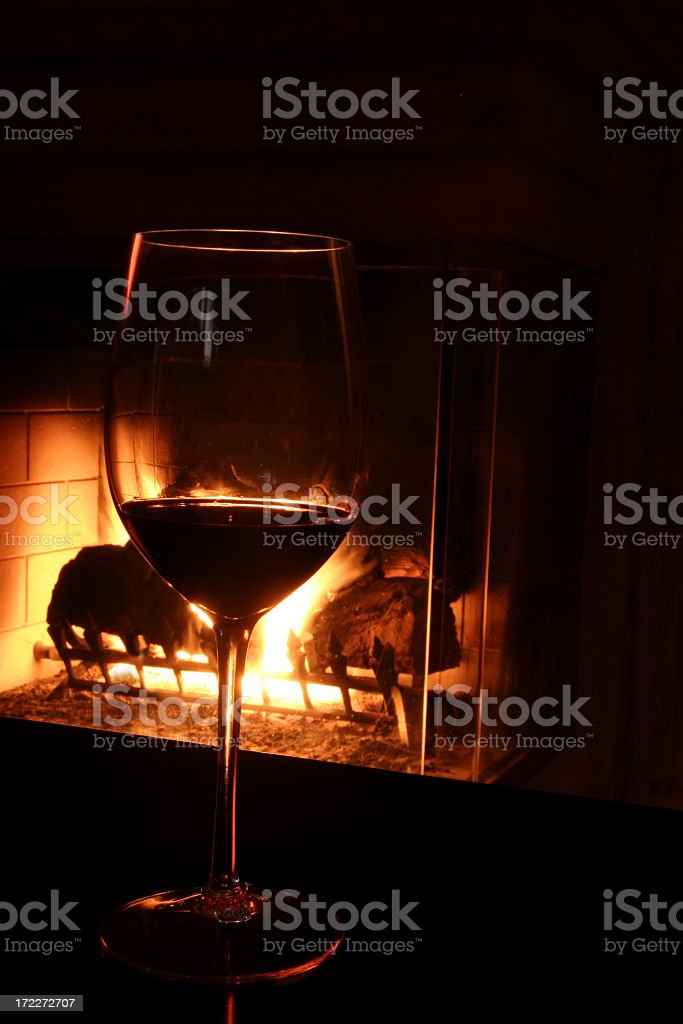 Red wine by the fire royalty-free stock photo