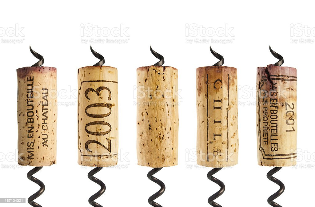 Red wine corks on white stock photo