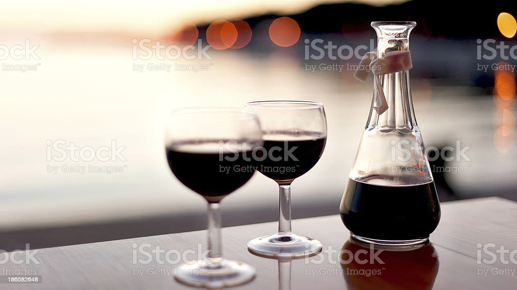 red wine for two in sunset royalty-free stock photo