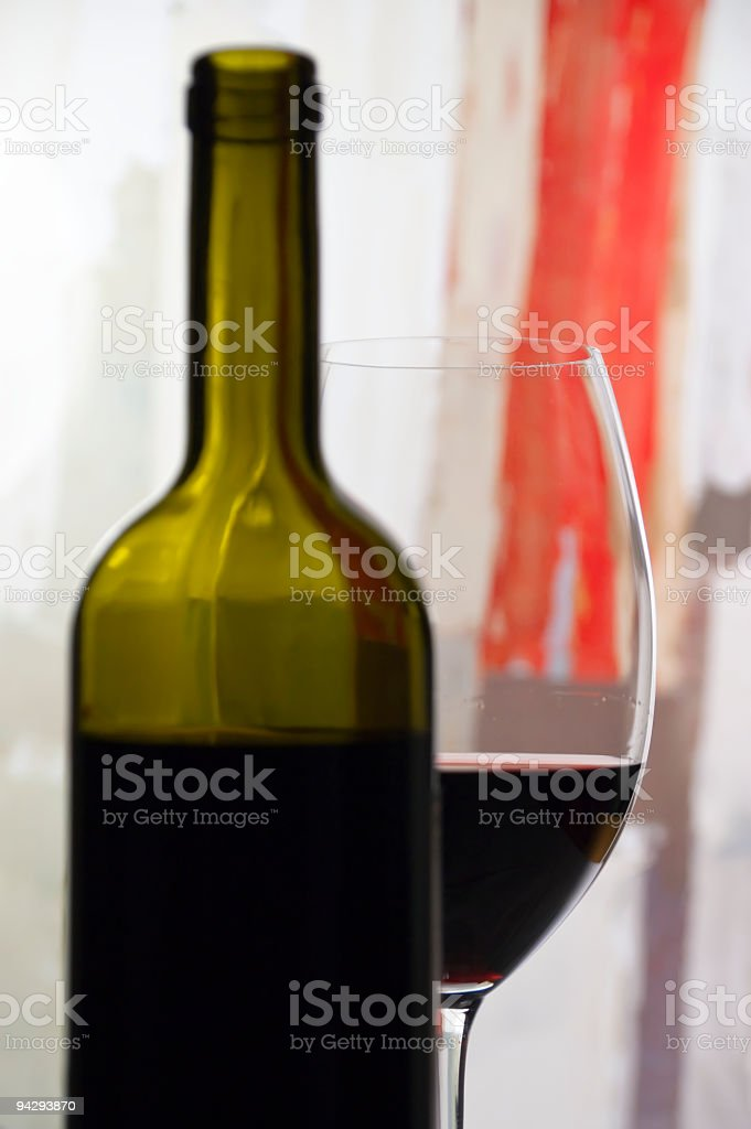 Red wine glass and a bottle stock photo