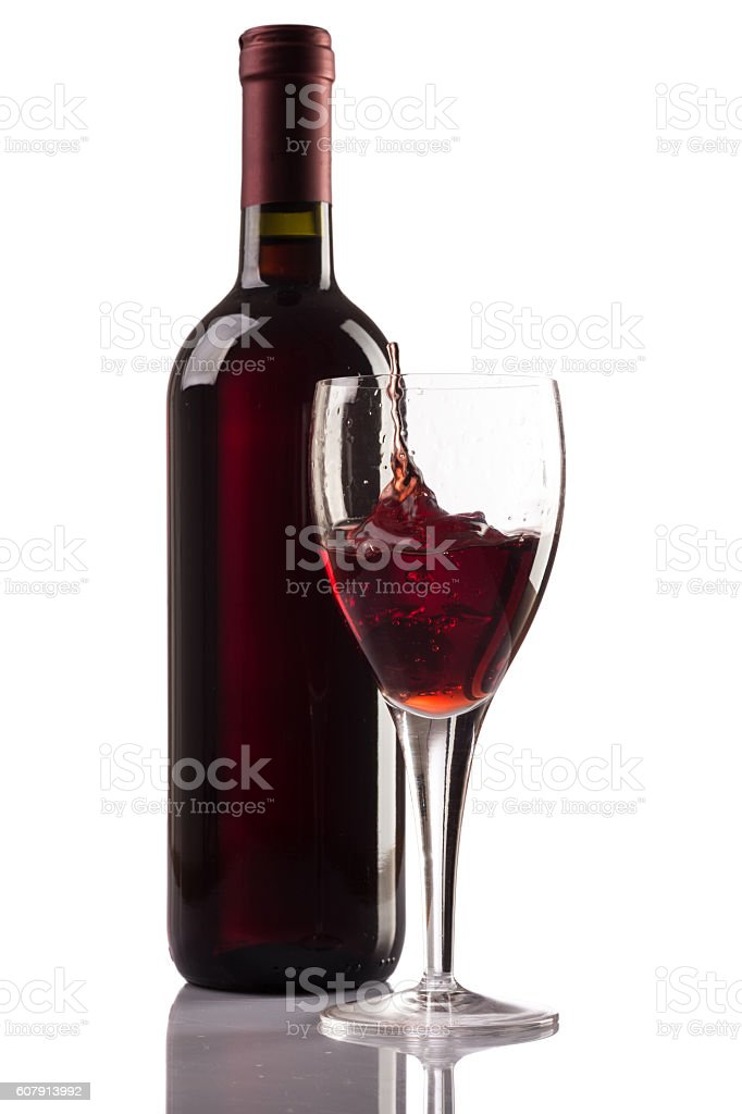 Red wine glass and bottle isolated on white background stock photo