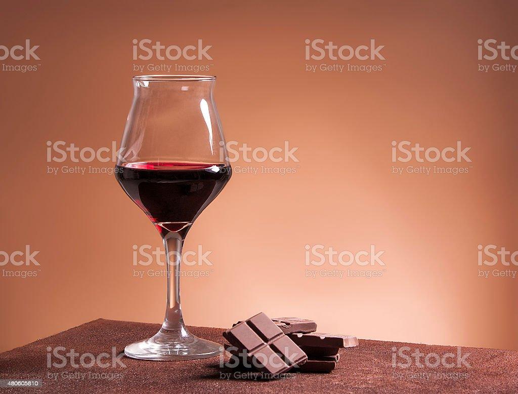 Red wine glass and chocolate stock photo