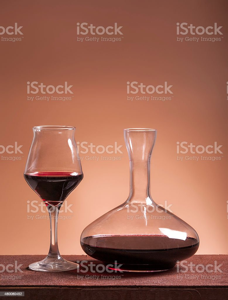 Red wine glass and filled decanter stock photo