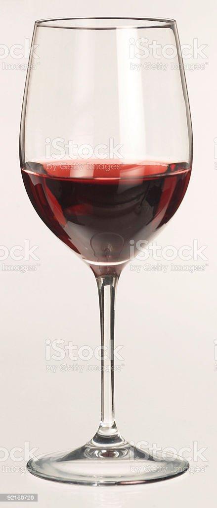 red wine glass half full stock photo