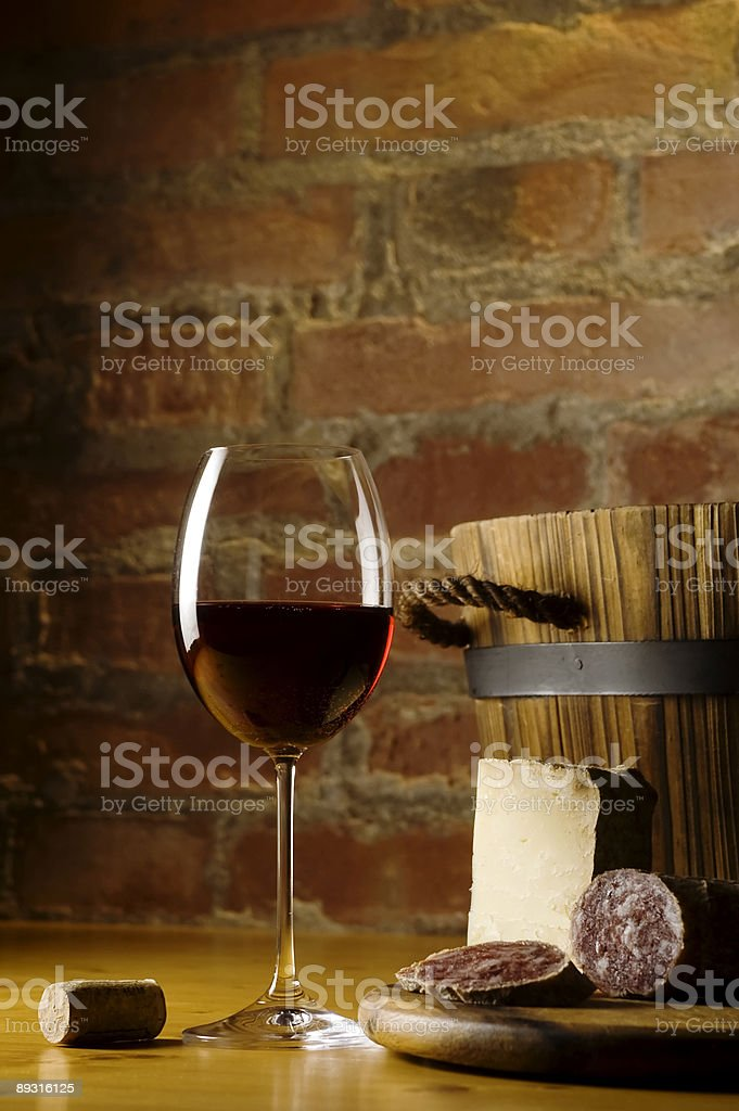 Red wine glass in rural kitchen royalty-free stock photo