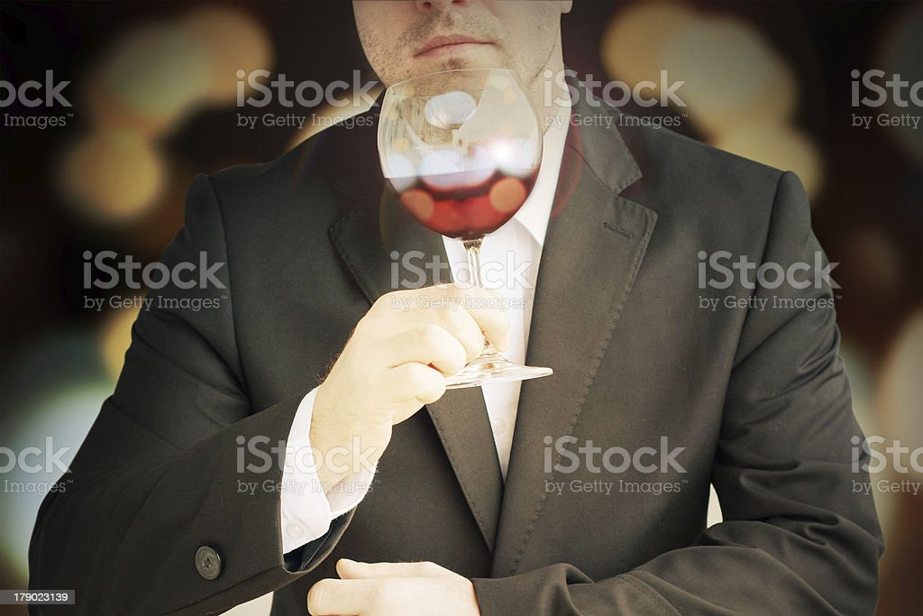Red wine glass in the men's hand royalty-free stock photo