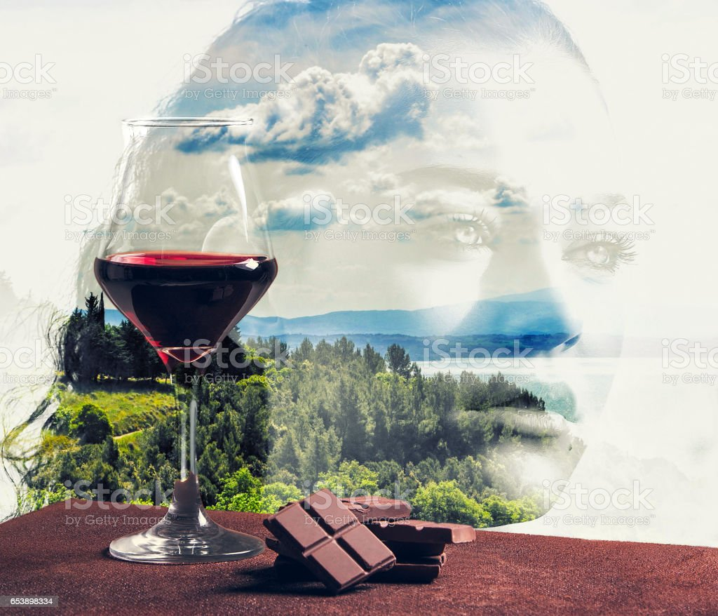Red wine glass with chocolate and girl portrait with landscape stock photo