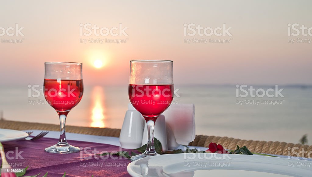 Red Wine glass with sunset. stock photo