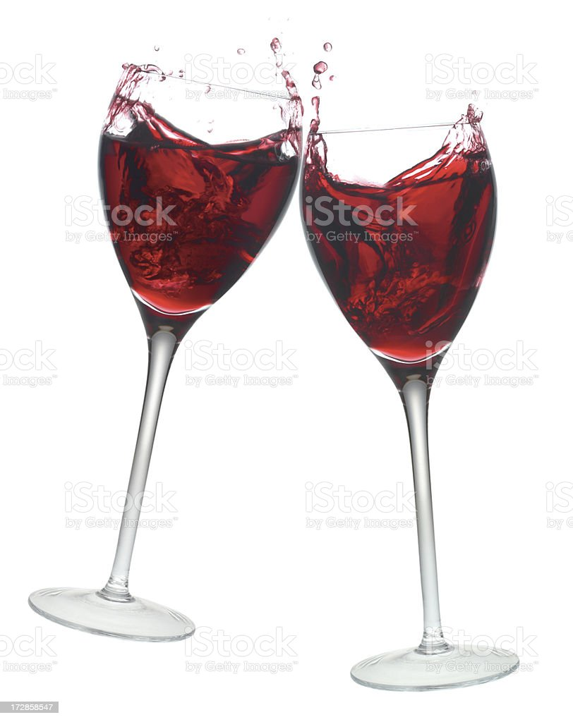 Red wine glasses in toast gesture. stock photo