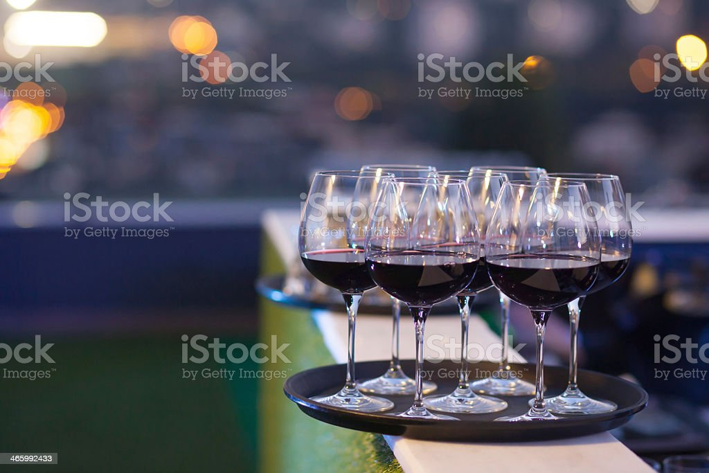 red wine glasses on tray stock photo