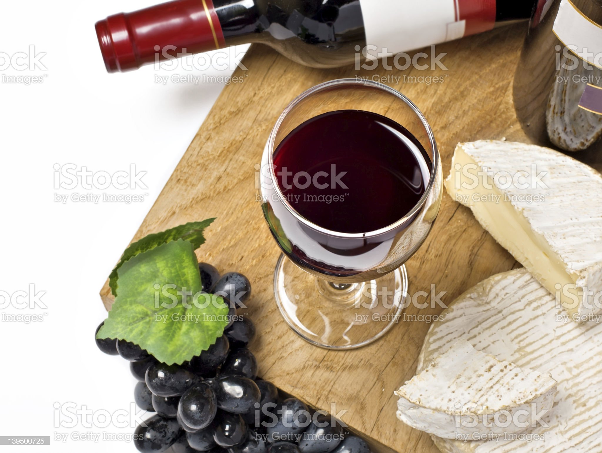 Red wine, grape, Brie and Camembert royalty-free stock photo
