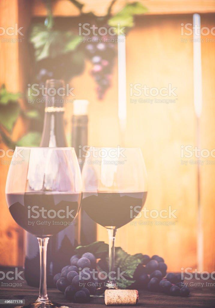 Red wine, grapes and wine bottles. Winetasting al fresco. stock photo