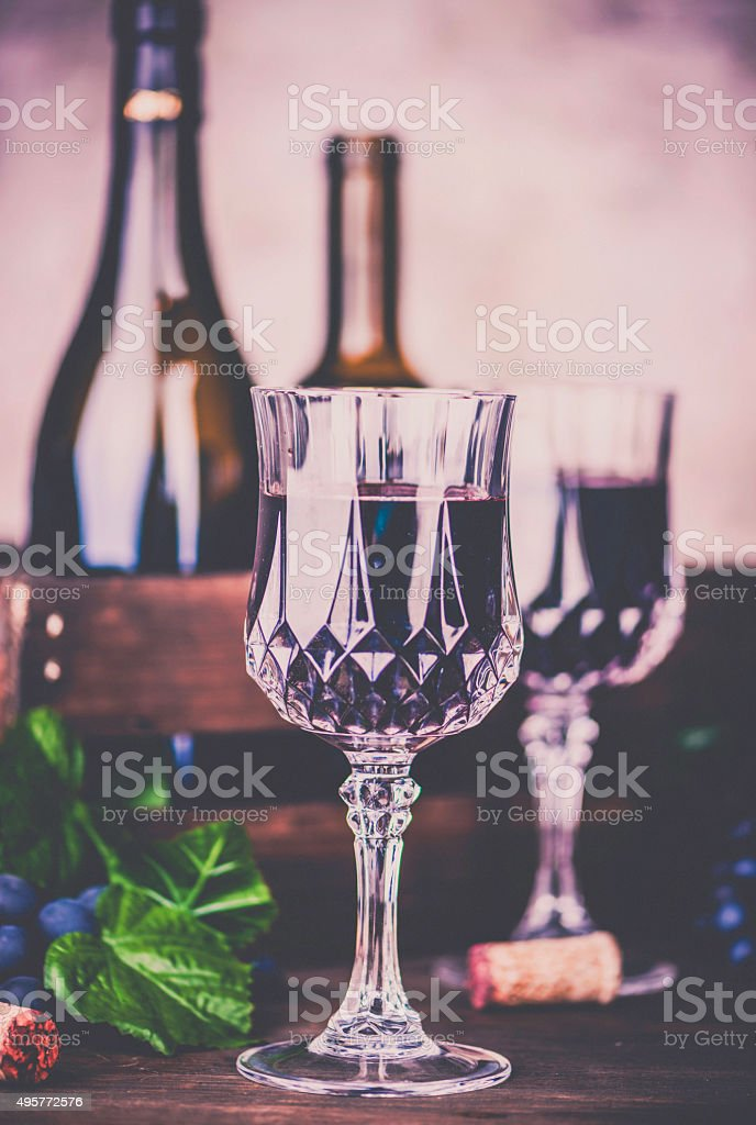 Red wine, grapes and wine bottles. Winetasting stock photo