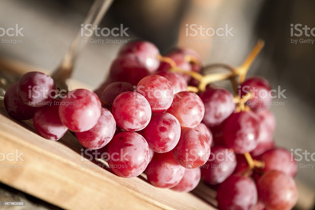 Red wine grapes over a wooden table royalty-free stock photo