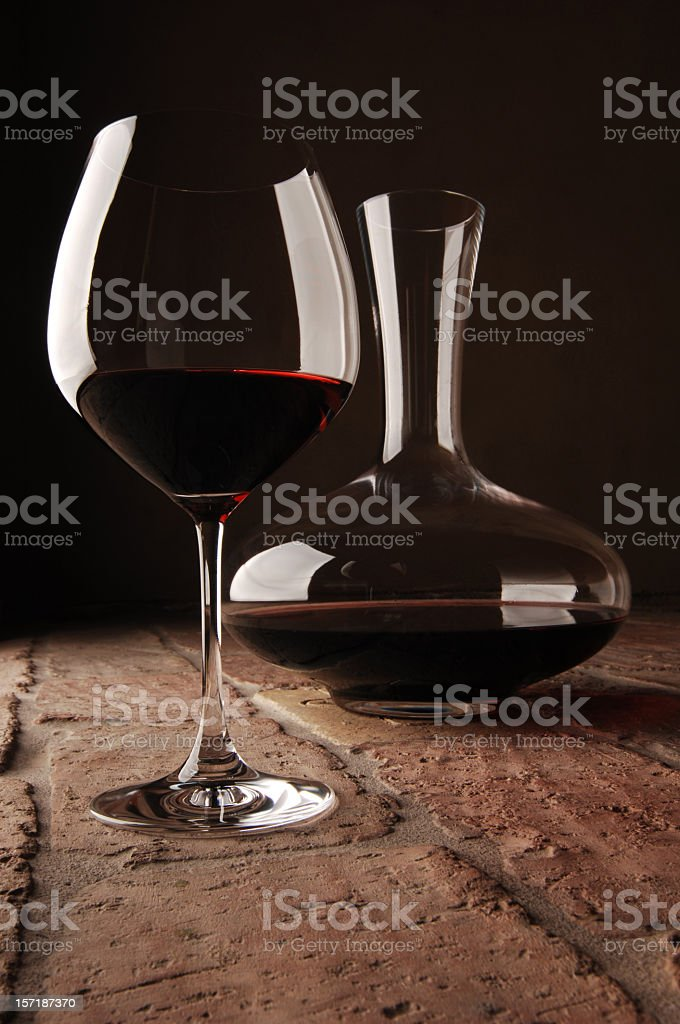 Red wine in a glass and decanter on a table royalty-free stock photo
