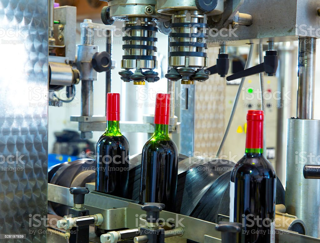 red wine in bottling machine at winery stock photo