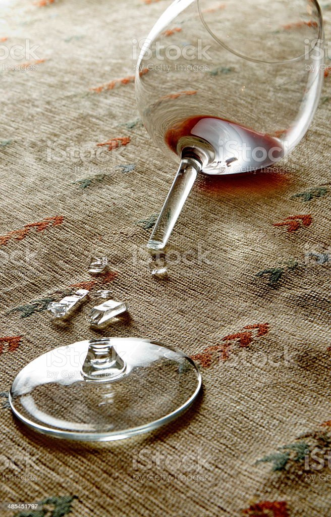 Red wine in broken glass stock photo