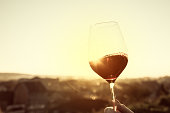 Red Wine In Crystal Glass Against Sunset