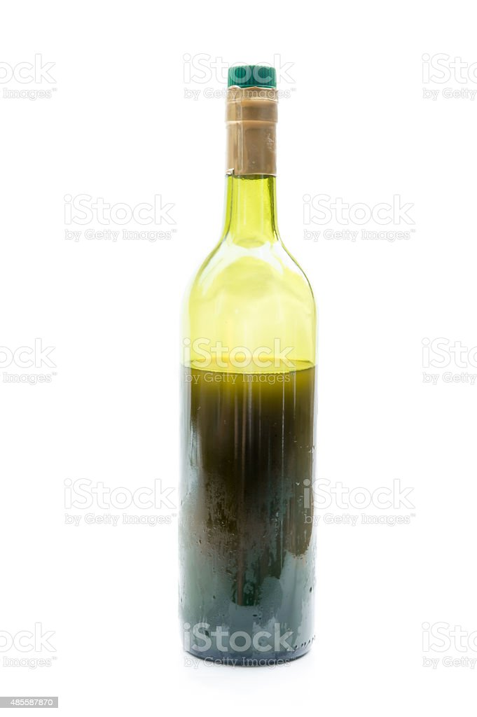 red Wine in glass bottle isolated on white background stock photo