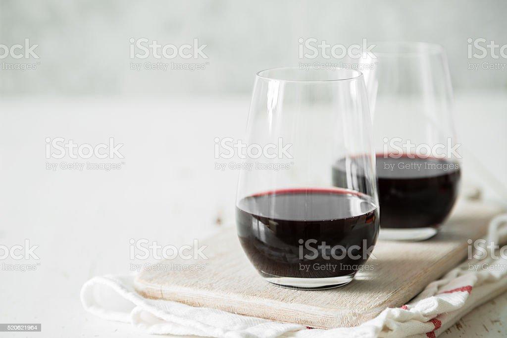 Red wine in glasses stock photo