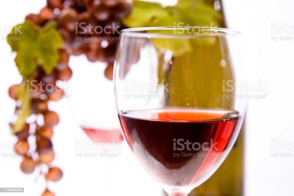 Red Wine in glasses with grapes and bottle background royalty-free stock photo