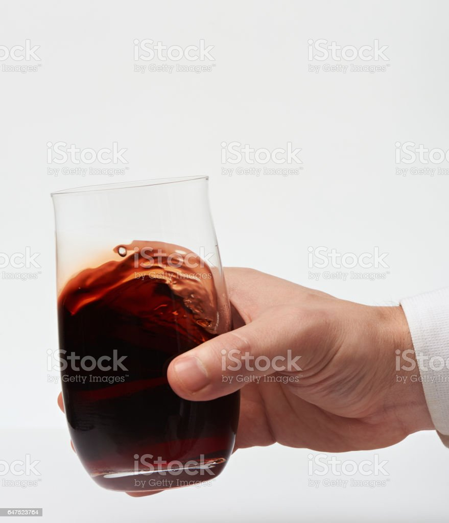 Red wine in stemless glass stock photo
