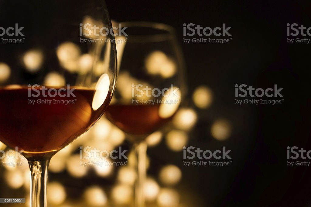 Red wine in two glasses with beautiful lights,black background stock photo