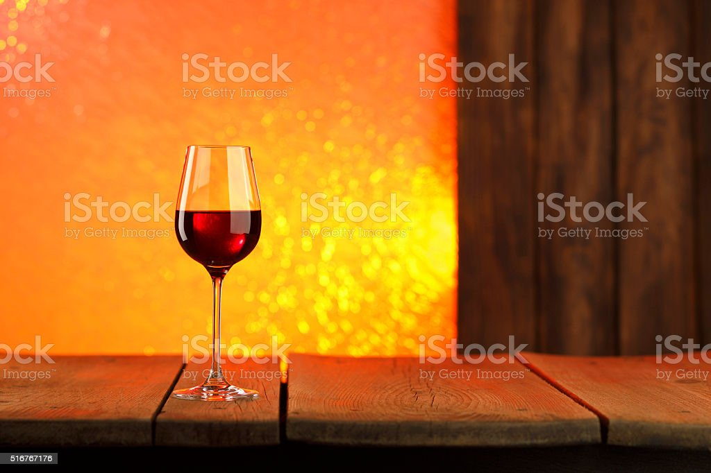 Red wine into stylish wineglass stock photo