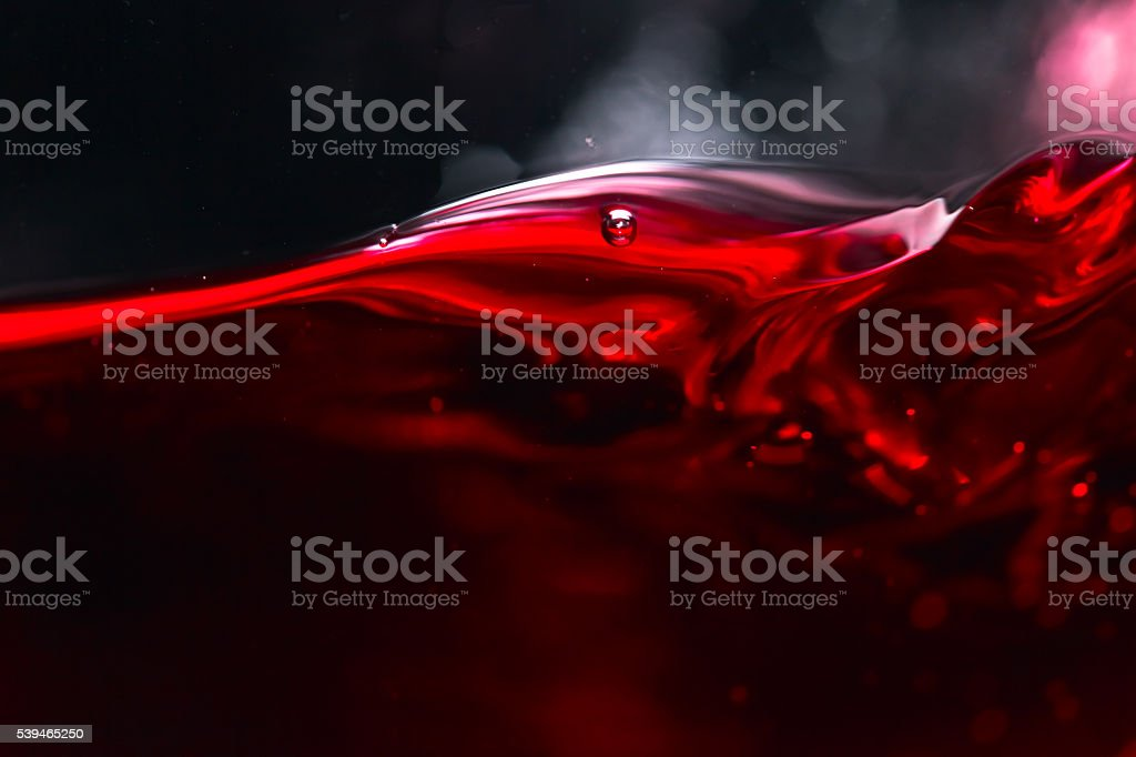 Red wine on black background stock photo