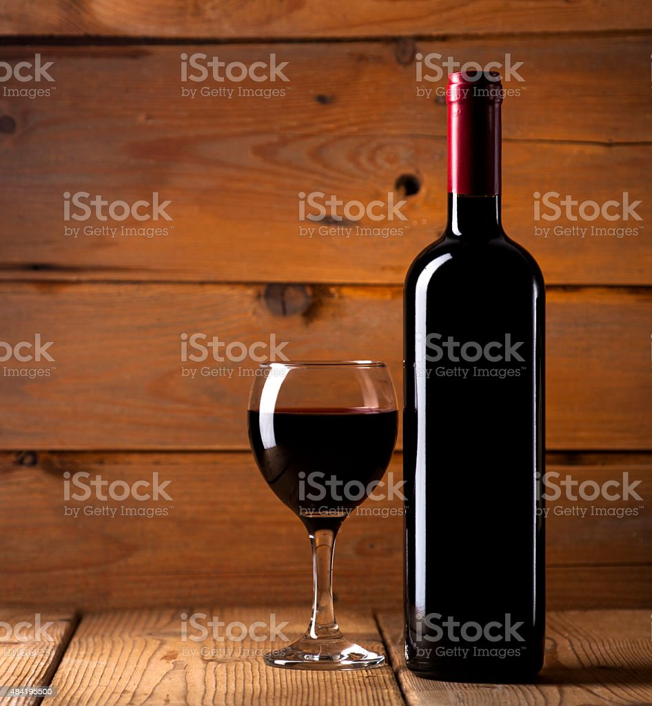 Red wine on wooden background stock photo