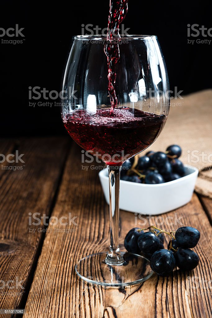 Red Wine (on wooden background) stock photo