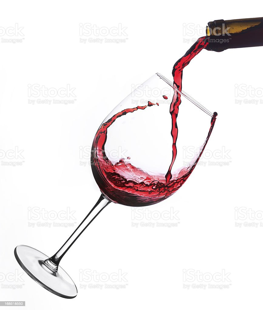 Red wine  poured into glas stock photo