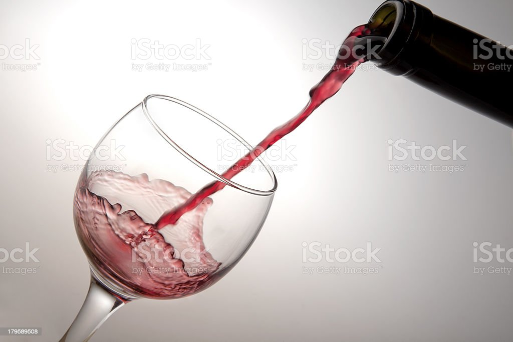 Red wine pouring down from a bottle royalty-free stock photo
