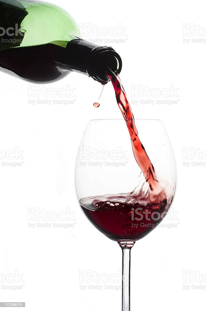 red wine pouring from bottle royalty-free stock photo