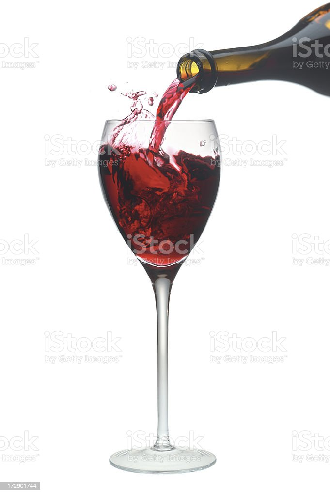 Red wine pouring into a glass. stock photo