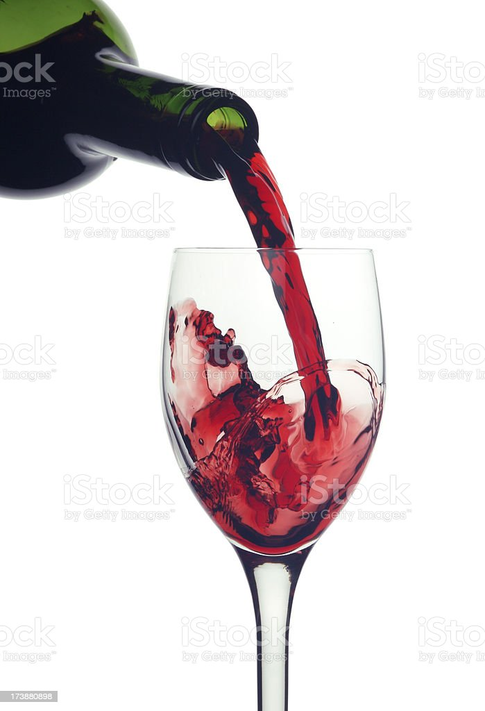 Red Wine pouring into a glass royalty-free stock photo