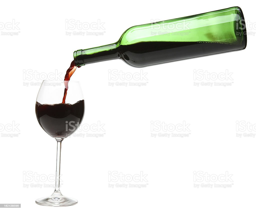 Red wine pouring into a wineglass. royalty-free stock photo