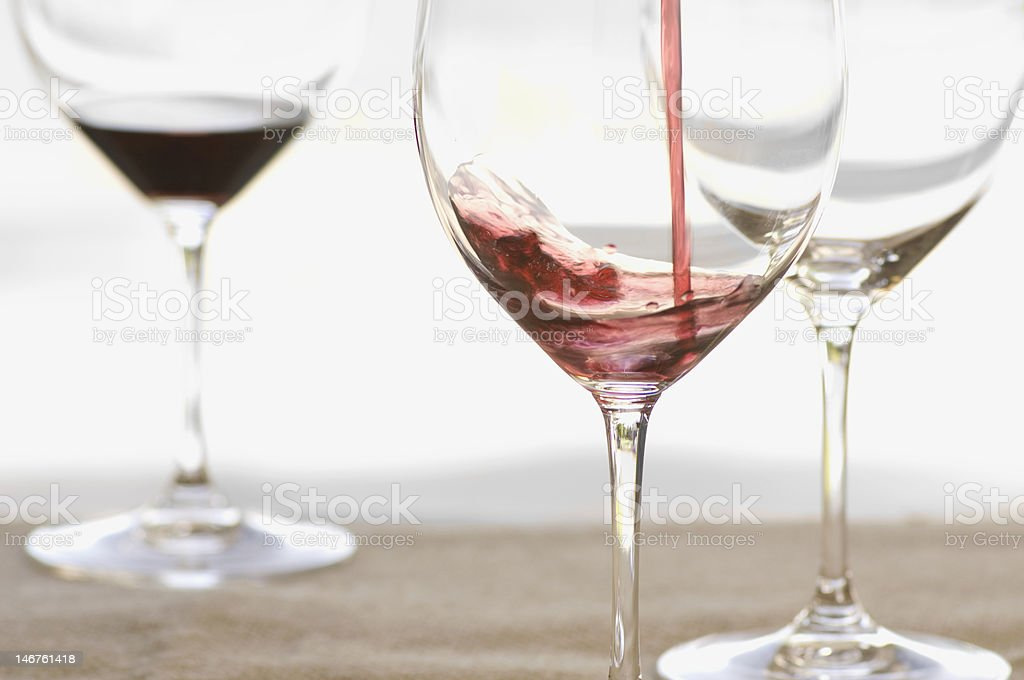 Red wine pouring into glass royalty-free stock photo