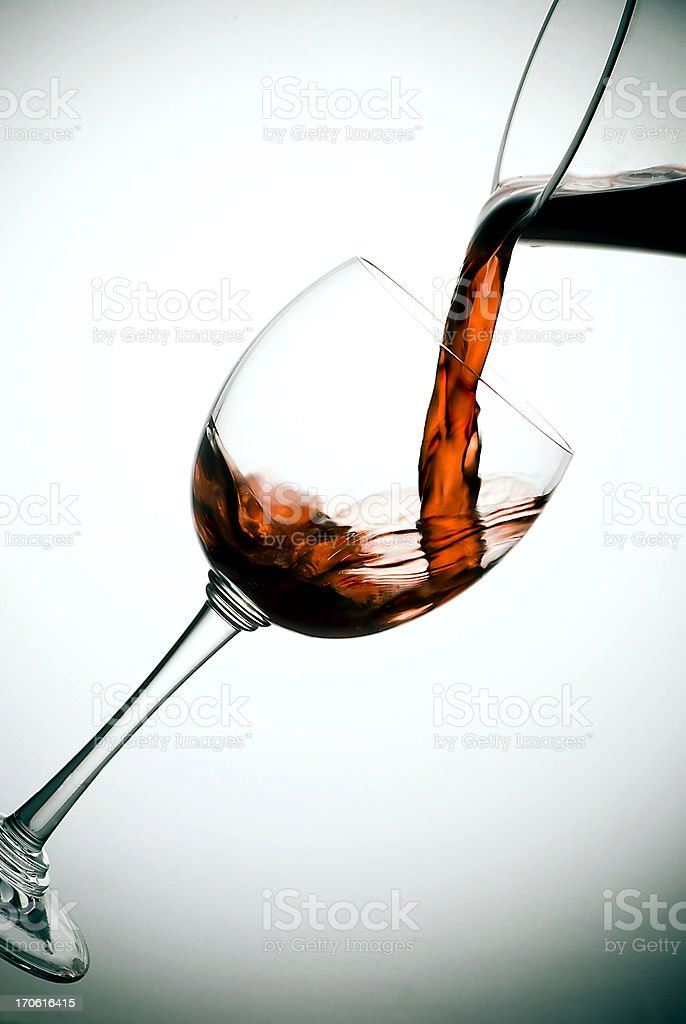Red wine pours into wineglass royalty-free stock photo