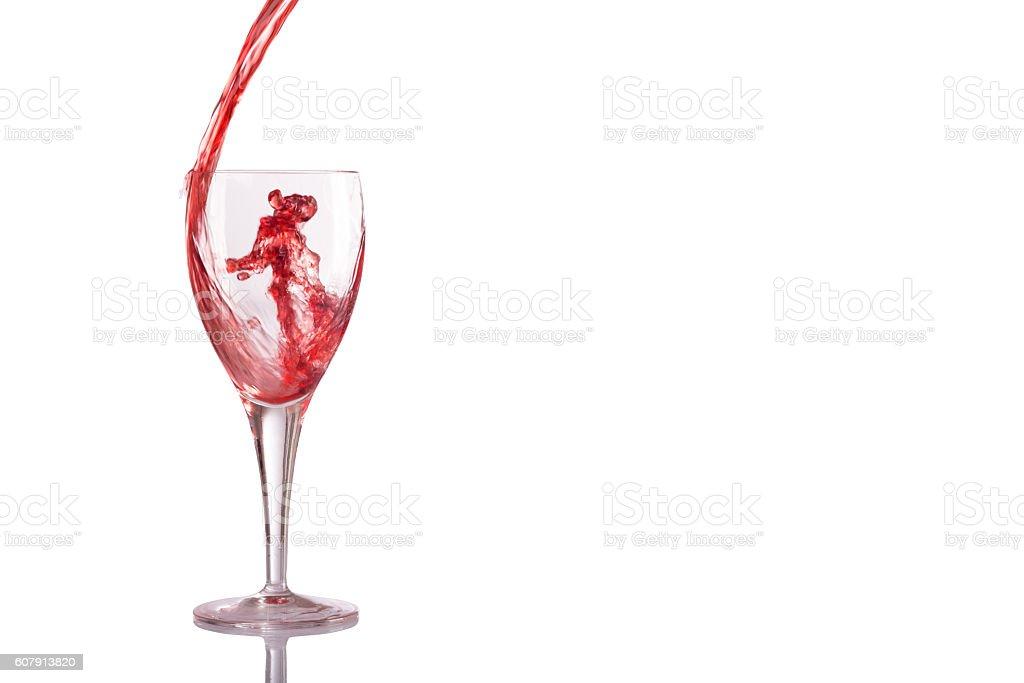 Red wine splash glass isolated on white background stock photo
